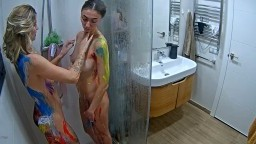 Milena and Monica wash paints from their bodies, Feb 7